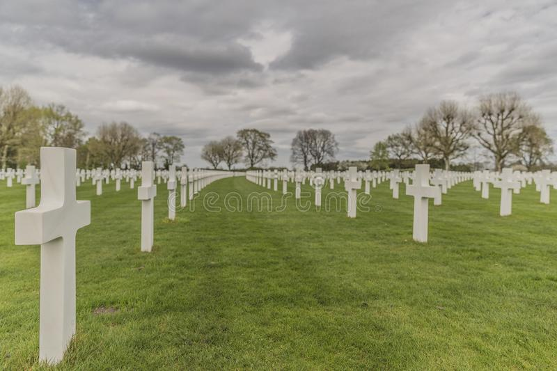 Image of crosses in the American Cemetery Margraten on a green grass in memory of soldiers killed in the war stock photography