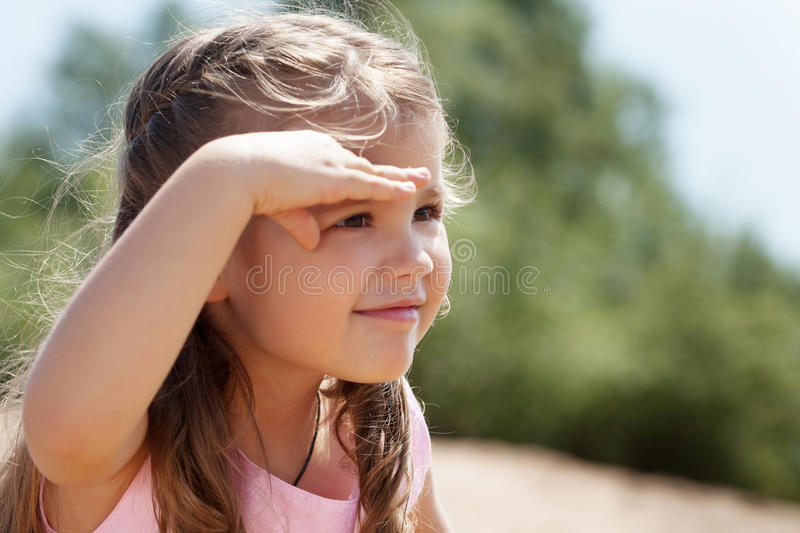 Image of cute little girl covers her eyes from sun royalty free stock photos