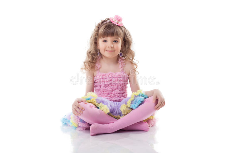 Image of cute little girl posing in candy costume stock photo