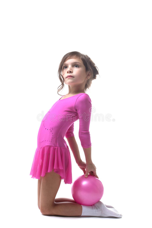 Image of cute little gymnast posing with ball royalty free stock photo