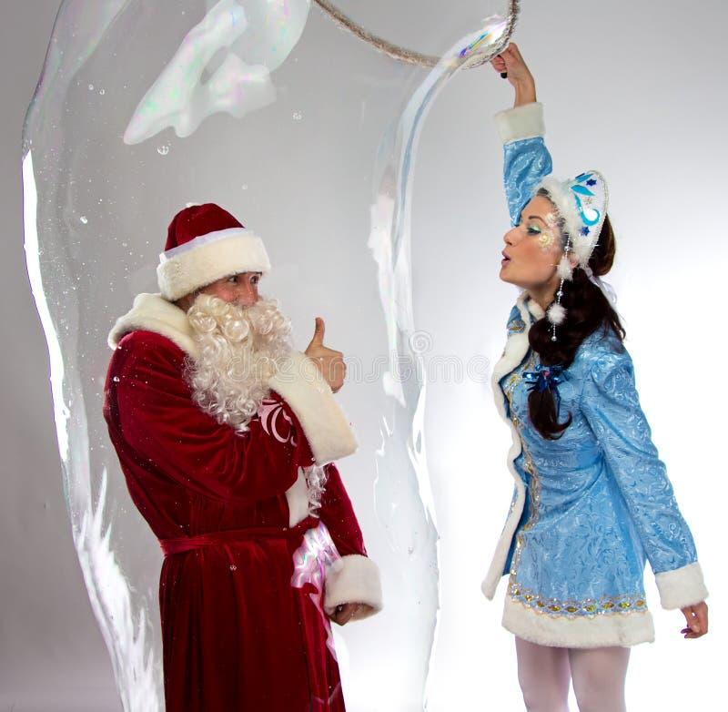 Image d'insede heureux de Santa la bulle de savon images stock