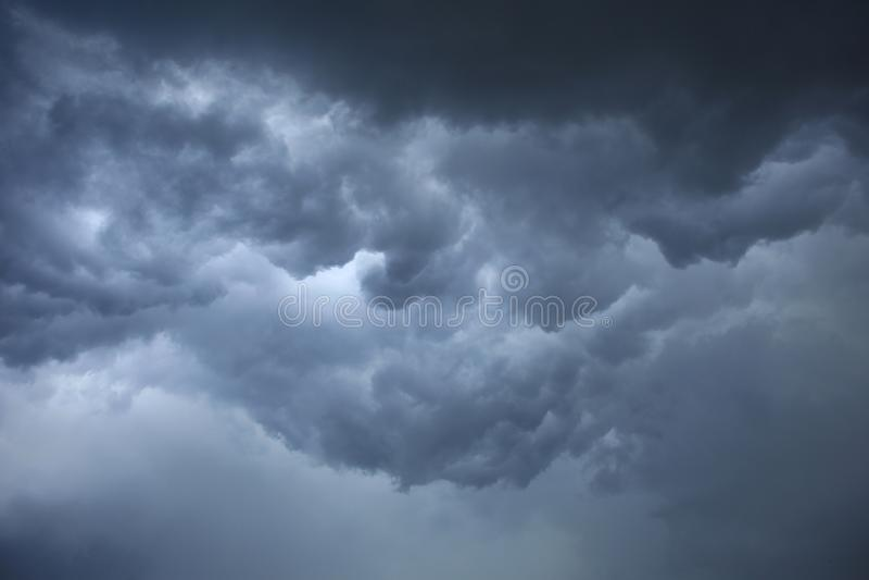 Dark ominous grey storm clouds. Image of dark ominous grey storm clouds royalty free stock images