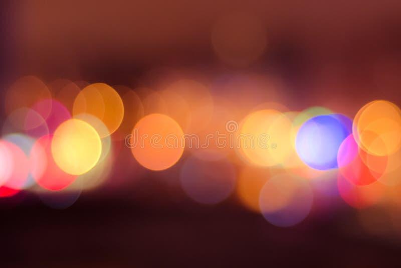 image de fond brouillé de bokeh avec les lumières colorées chaudes Ton de vintage photo libre de droits