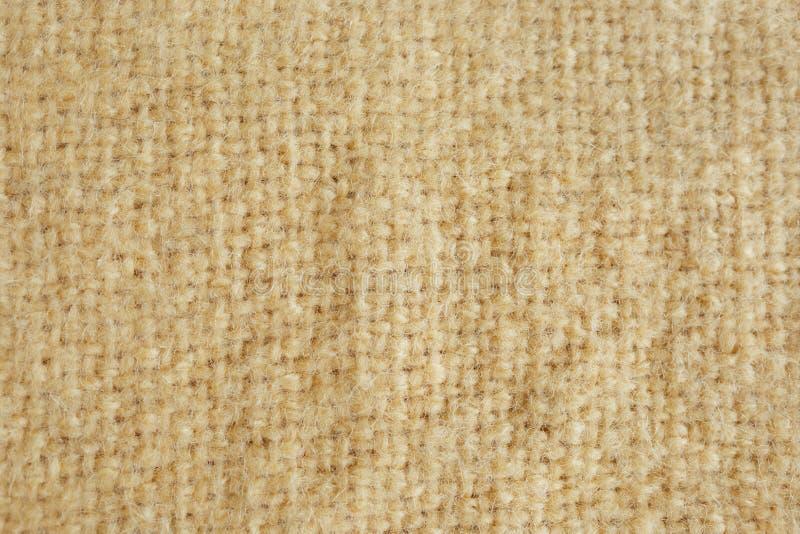 Image de fond d'un tapis jaune de fourrure molle fond de texture de plan rapproché d'ouatine de moutons de laine Tissu jaune de f photos stock