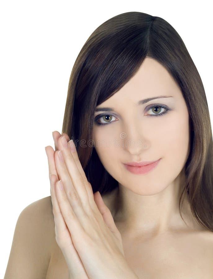 image de visage de sourire de femme avec la main à la joue photographie stock