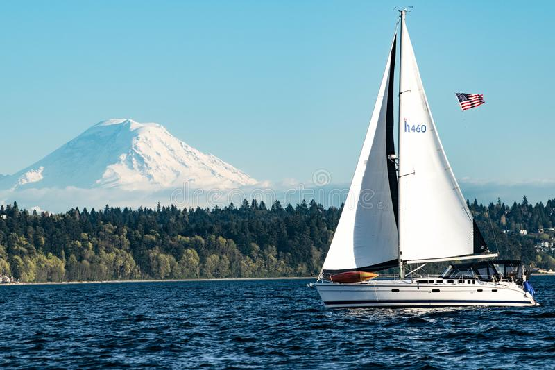 Sailing in the shadow of Mount Rainier on Puget Sound royalty free stock photo