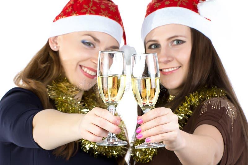 Image des femmes de sourire avec les verres photo stock