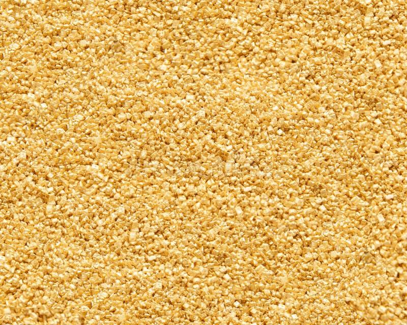 Background of powder golden crystals stock photos