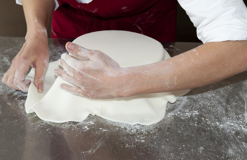 Layer of sugar paste placed on the cake royalty free stock photography
