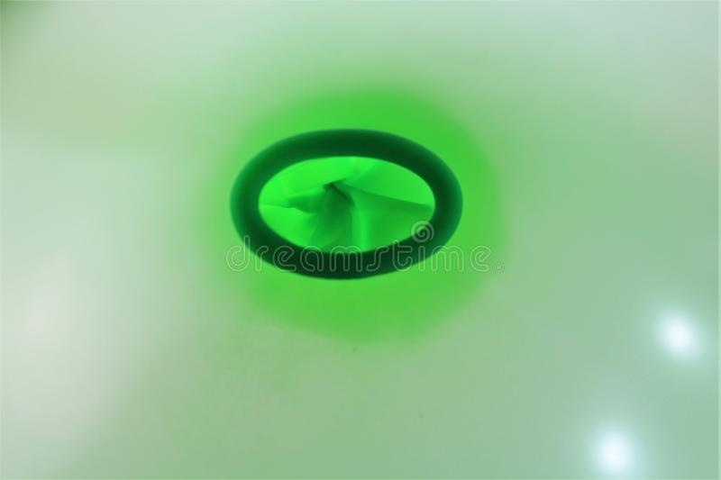 An image of a detail of a green balloon ring hole. Abstract stock image