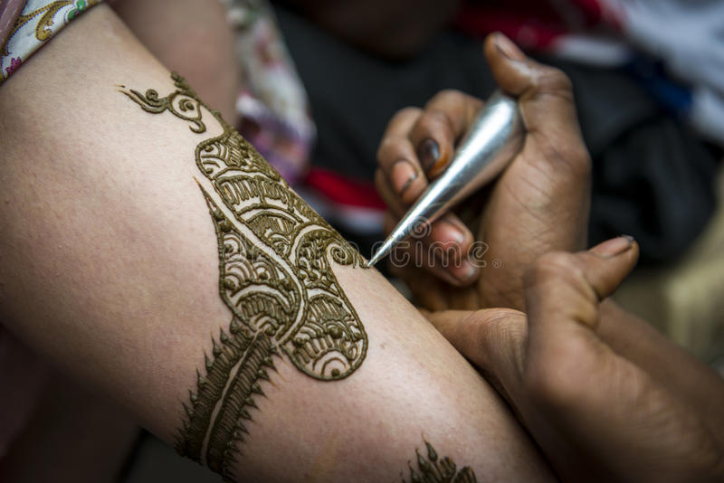 Image detail of henna being applied to arm stock images