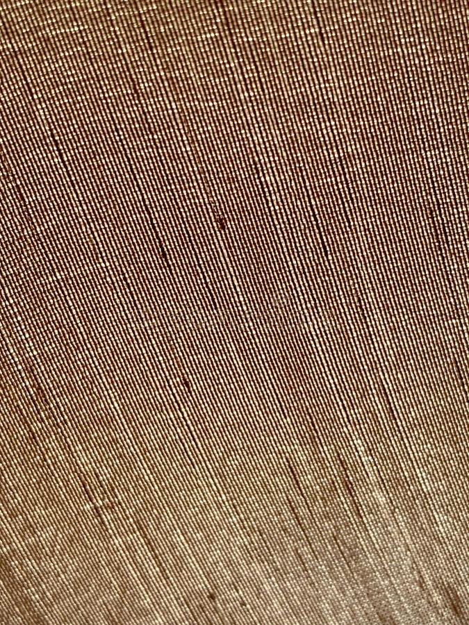 Image of detail and texture of textile. You can see the fiber of the tan color cloth royalty free stock photos