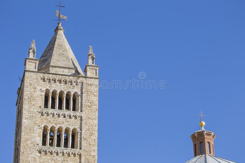 Image with detail of the tower of the Cathedral of San Cerbone. In Marina Marittima Tuscany Italy royalty free stock photos