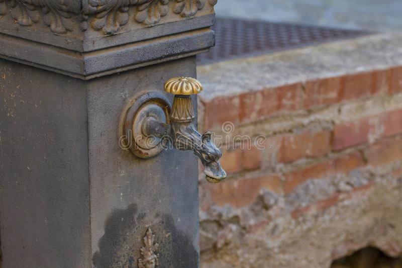 Image with detail of a wrought iron fountain. Image horizontal with detail of a wrought iron fountain royalty free stock photo