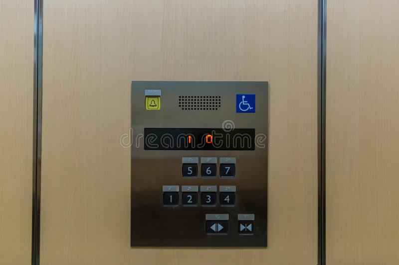Image of disabled lift button. Stainless steel elevator panel push buttons for blind and disability people. Push Button For the di. Sabled. Care and technology royalty free stock photography