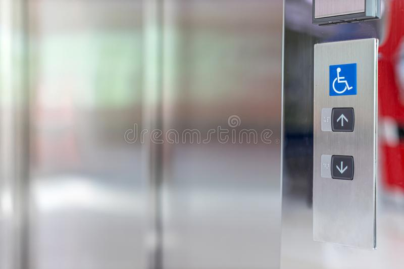 Image of disabled lift button. Stainless steel elevator panel push buttons for blind and disability people. Push Button For the di. Sabled. Care and technology stock photo