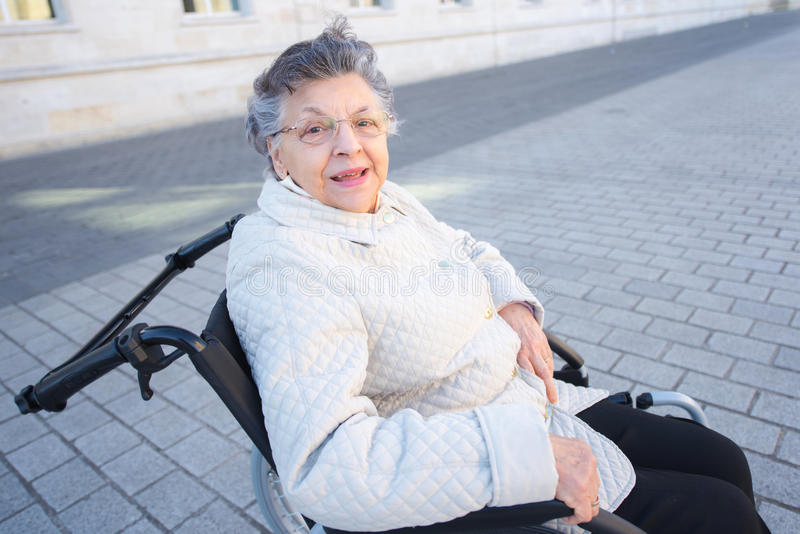 Image disabled positive old woman on wheelchair stock image