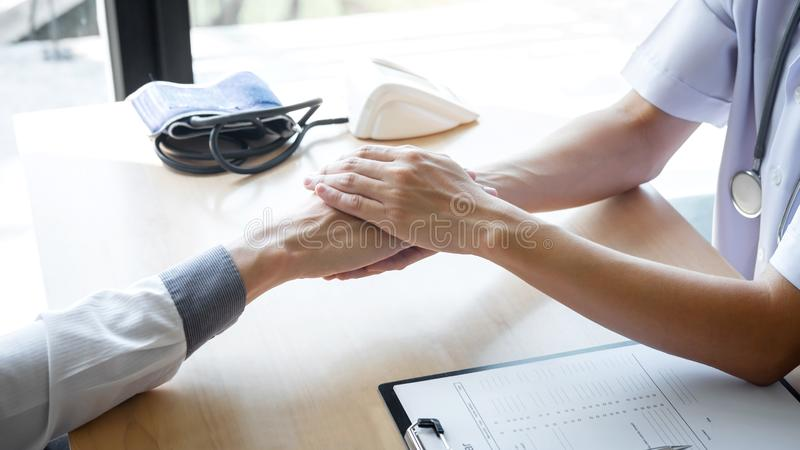 Image of doctor holding patient`s hand to encourage, talking with patient cheering and support stock image
