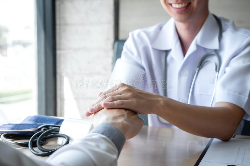 Image of doctor holding patient`s hand to encourage, talking with patient cheering and support royalty free stock photo
