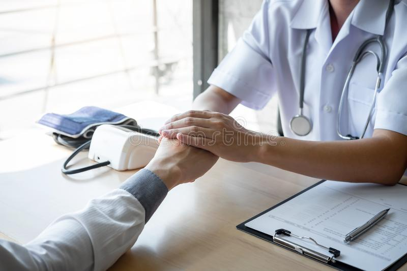 Image of doctor holding patient`s hand to encourage, talking with patient cheering and support royalty free stock image
