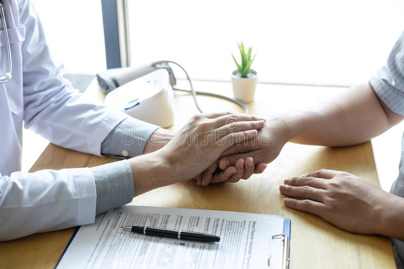 Image of doctor holding patient`s hand to encourage, talking with patient cheering and support royalty free stock photos