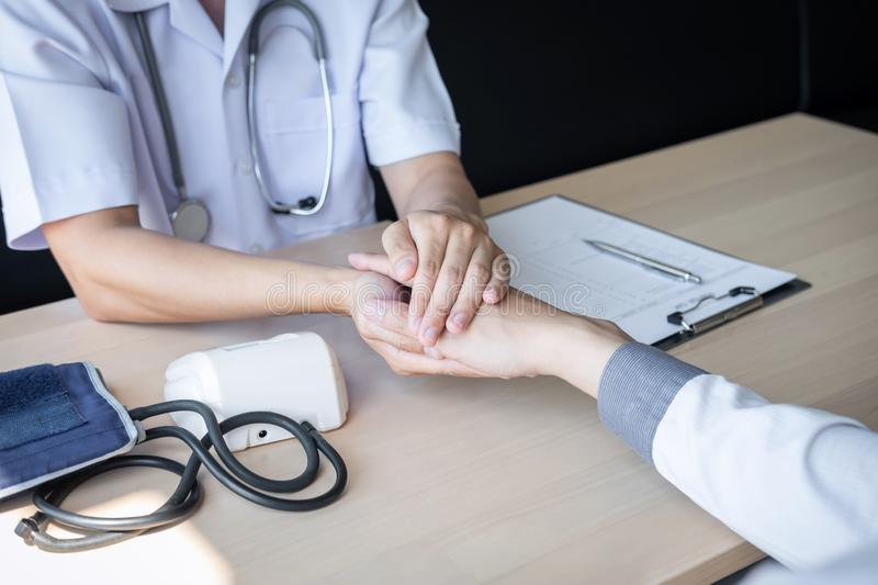 Image of doctor holding patient`s hand to encourage, talking with patient cheering and support stock photography