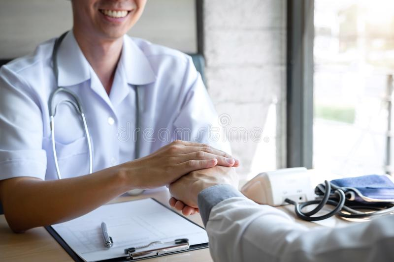 Image of doctor holding patient`s hand to encourage, talking with patient cheering and support royalty free stock photography