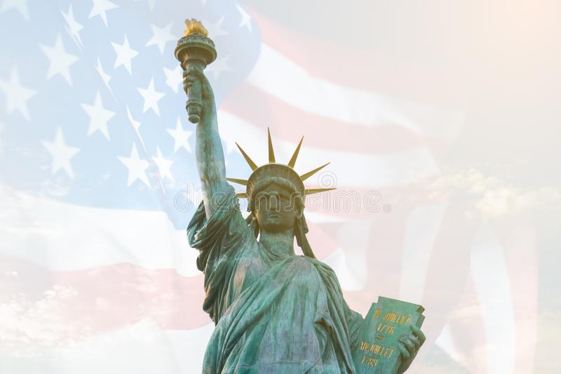 Image of double exposure statue of liberty and USA flag. Background for Independence day or Memorial day.  stock image