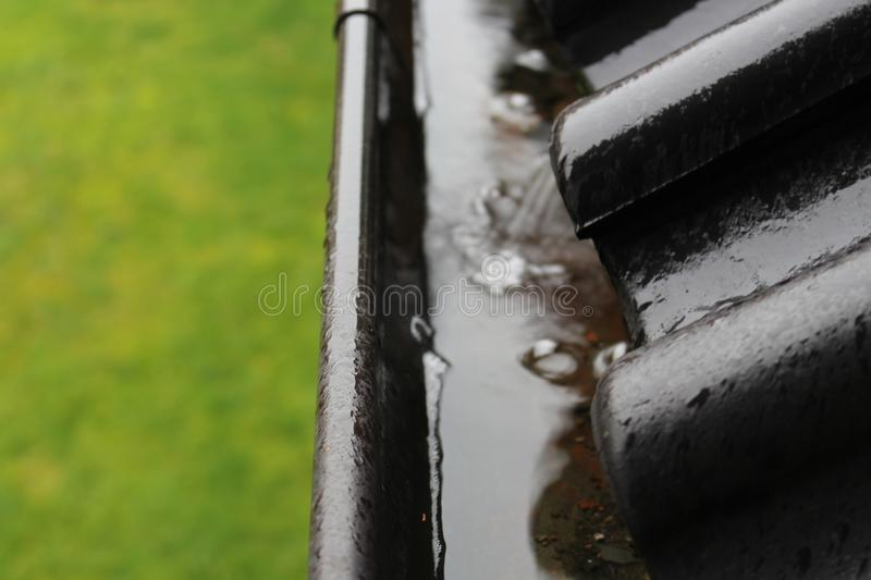An image of a drain with raindrops stock image