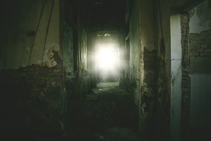 Empty corridor toward sunlight in a spooky house stock image