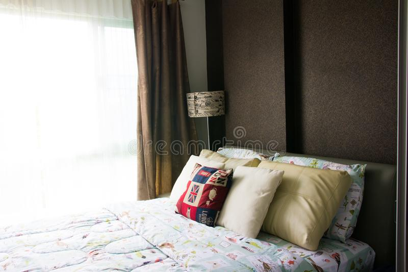 Empty modern bed in bedroom stock images