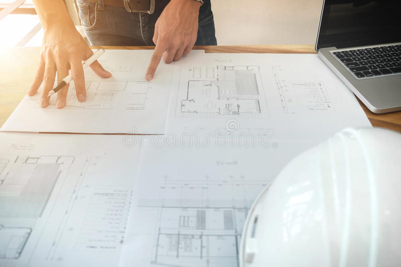 Image of engineer or architectural project, Close up of architects engineering working on blueprint with engineering equipment to royalty free stock image