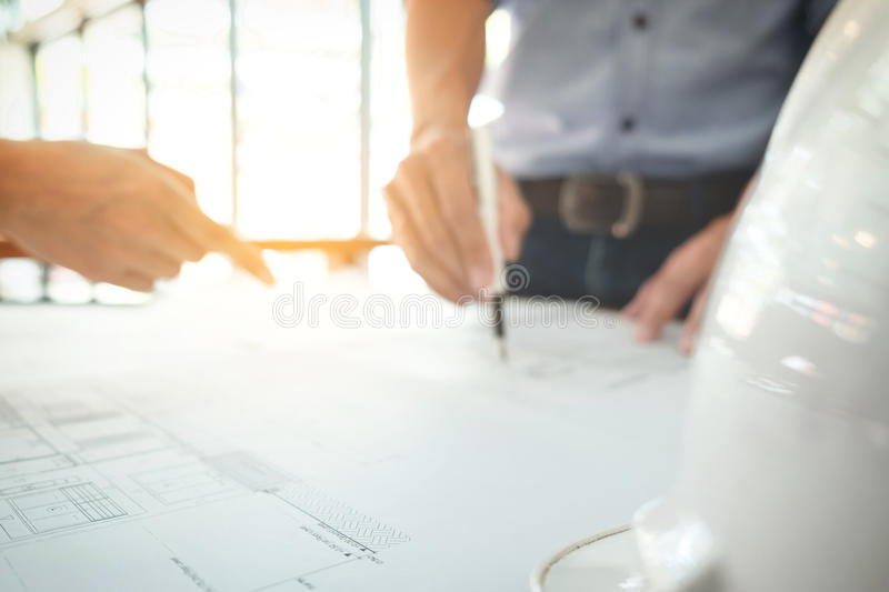 Image of engineer or architectural project, Close up of hands ar. Chitects engineering working on blueprint with engineering equipment tool, blurred background stock photo