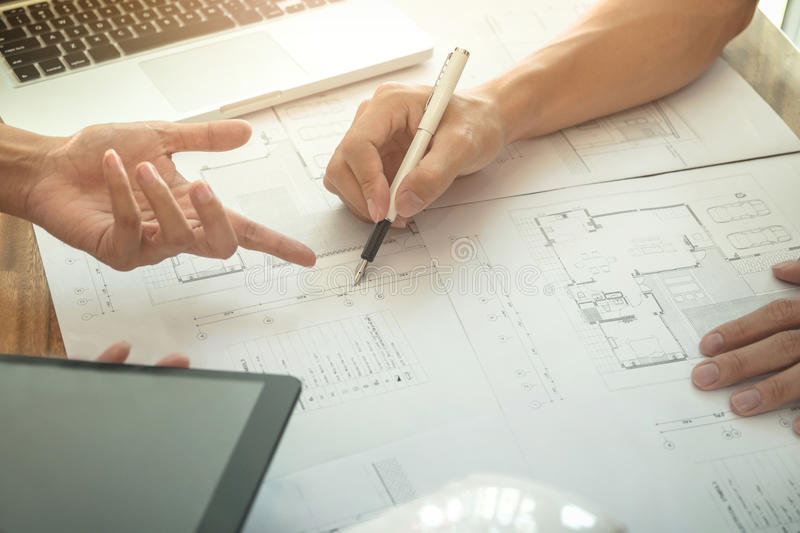 Image of engineer or architectural project, Close up of hands ar. Chitects engineering working on blueprint with engineering equipment tool, Construction concept royalty free stock images