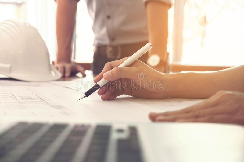 Image of engineer or architectural project, Close up of hands ar. Chitects engineering working on blueprint with engineering equipment tool, Construction concept stock image