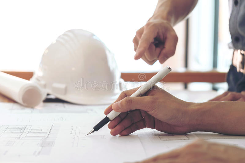 Image of engineer or architectural project, Close up of hands ar. Chitects engineering working on blueprint with engineering equipment tool, Construction concept stock photos