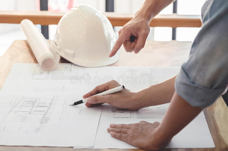 Image of engineer or architectural project, Close up of hands ar. Chitects engineering working on blueprint with engineering equipment tool, Construction concept stock photography