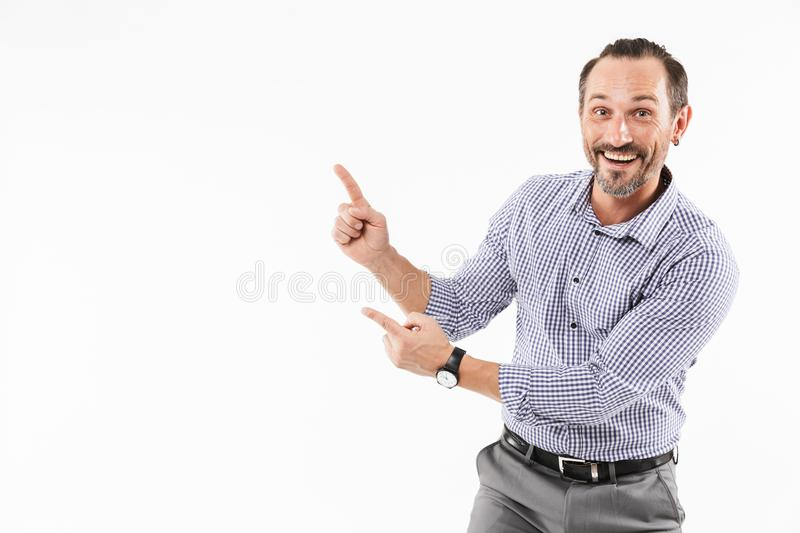 Excited surprised adult businessman showing copyspace. Image of excited surprised adult businessman over white background. Looking camera showing copyspace stock images