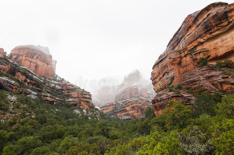 Panoramic photograph of snow covered red rocks at Fay Canyon in Sedona. Arizona. stock photo