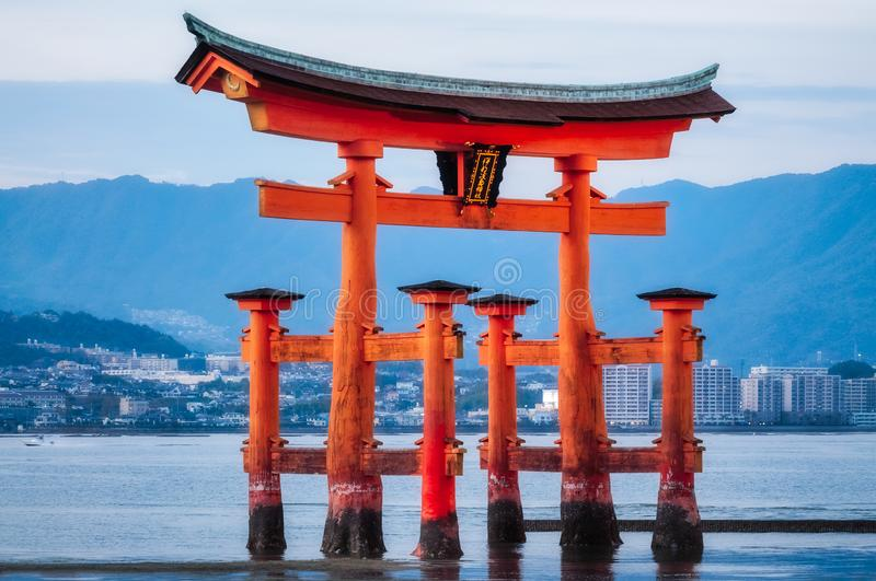 Image of the famous Torii Gate of Miyajima Island, Japan. World heritage listed Shinto Shrine at Sunset with the tide coming in, making it look like it is stock image