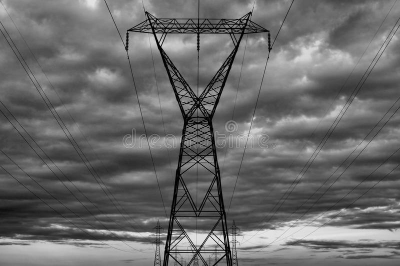 Electrical Transmission Towers. Image featuring electrical transmission towers, which are used to carry electricity stock photo