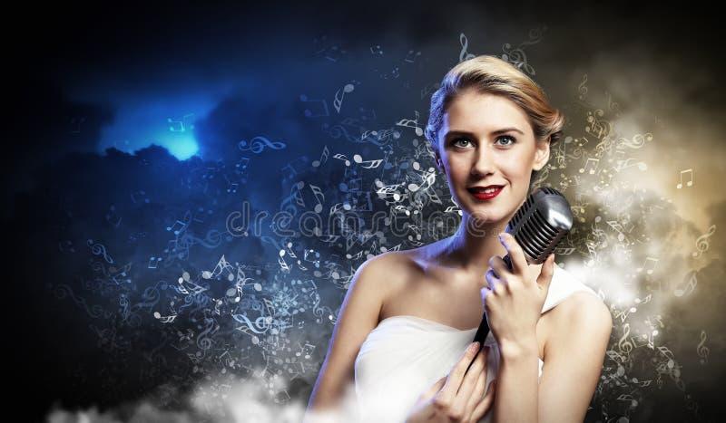 Female blonde singer royalty free stock images