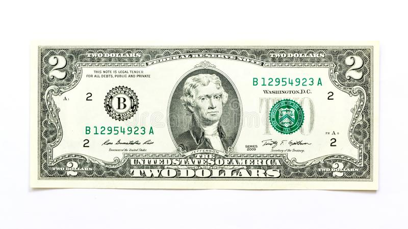 Two Dollar Bill in White Background royalty free stock photos