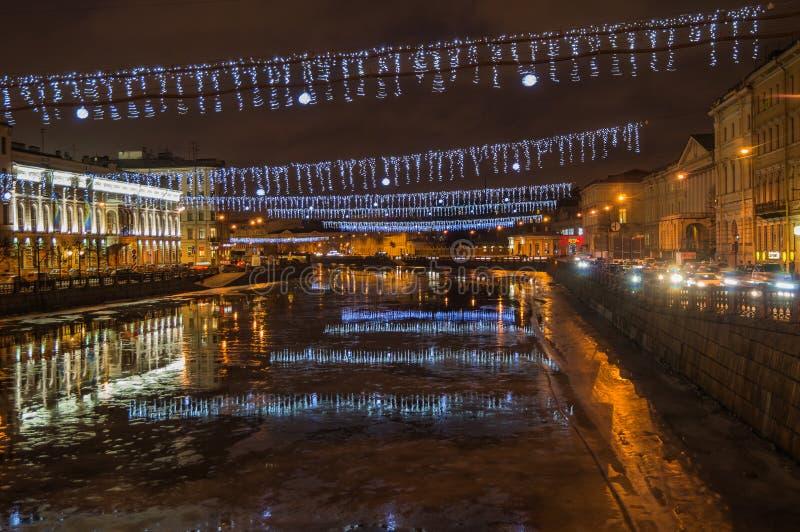 An image of the Fontanka river, SAINT PETERSBURG,Russia. DECEMBER,25,2016, SAINT PETERSBURG :The lights reflection in the Fontanka river; night winter; Saint stock image