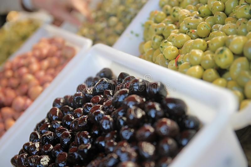 Olives. Image of fresh green olives in oil royalty free stock photography