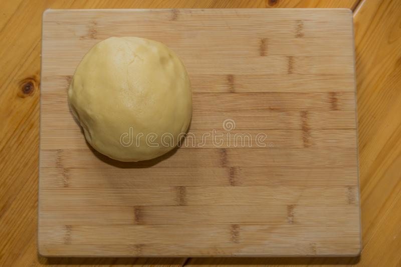 Image of a fresh raw dough for patty or cookies on a wooden surface stock photography