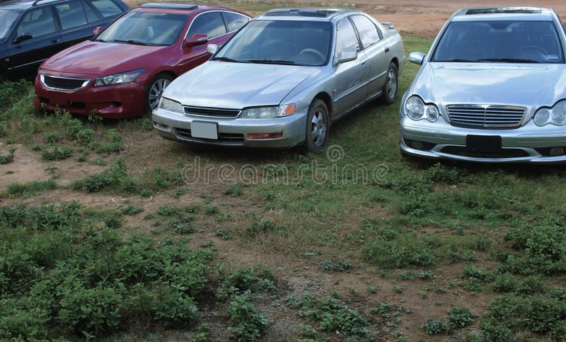 Image of front side of four car showing headlights suitable for commercial illustration of used cars concepts. Front side of four used cars with no logos in stock image