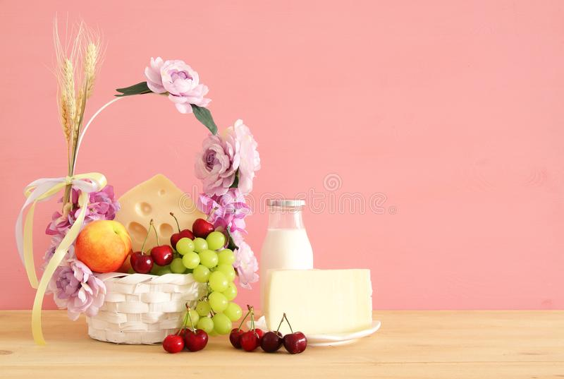 Download Image Of Fruits And Cheese In Decorative Basket With Flowers Over Wooden Table. Symbols Of Jewish Holiday - Shavuot. Stock Photo - Image of healthy, cherry: 116161214