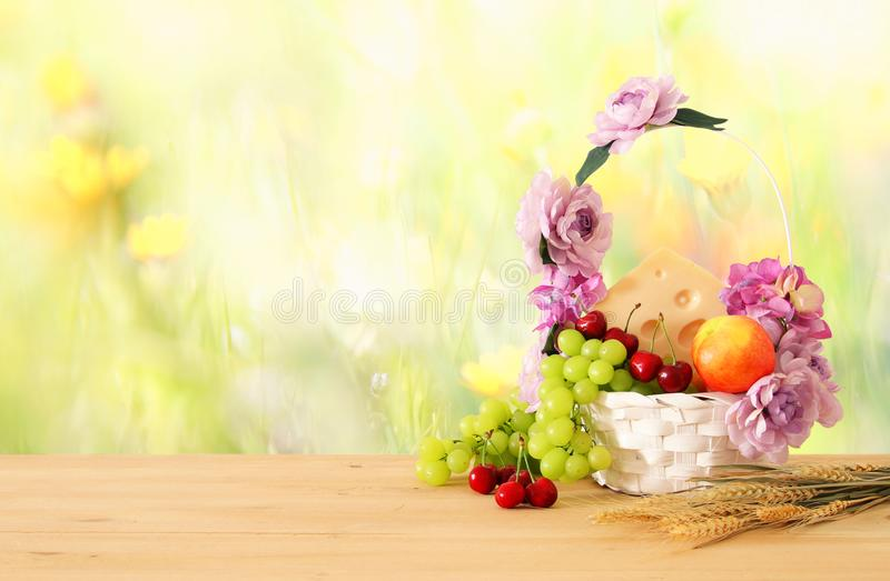 Download Image Of Fruits And Cheese In Decorative Basket With Flowers Over Wooden Table. Symbols Of Jewish Holiday - Shavuot. Stock Photo - Image of judaism, diet: 116167650