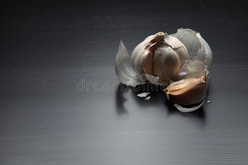 Image of garlic on dark wooden table stock photography